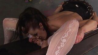 Nasty slut in black lures an innocent blonde to lick her ass