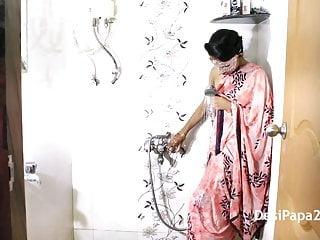 Fiery performance strip Mumbai desi college girl in shower perform a wet strip show