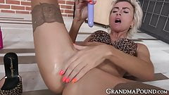 Mature sleazy woman pleasing her pussy with big sex toys