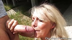 Curvy mature lady slobbers on fat younger cock with passion