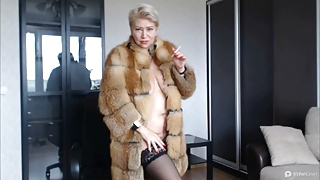 Hot sexy Russian MILF slut in a fur coat and a cigarette...