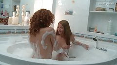 Lesbian cuties licking and fucking wet pussy in the baththub