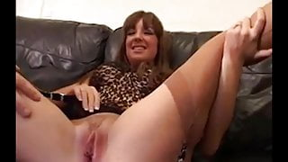 Horny slut in stockings takes two dicks