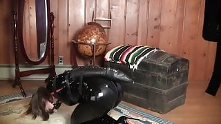 Elizabth Andrews Strapped and Panel Gagged in a Black Catsui