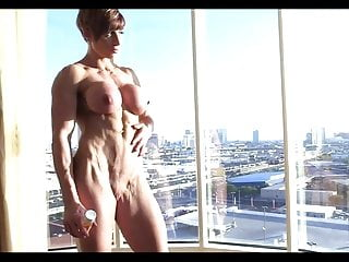 Busty nude muscle Nude muscle posing with a view