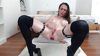 Beautiful girl with fake tits prolapses her ass and squirts