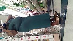 Thick tatted ebony MILF flaunts big ass in green dress. Prt1