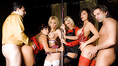 Four Horny Strippers Take Turns Pleasuring Two Lucky Cocks