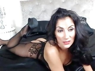 Vertical striped body suit Raven haired milf in sexy body suit teases
