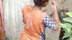 Desi girl takes an outdoor bath