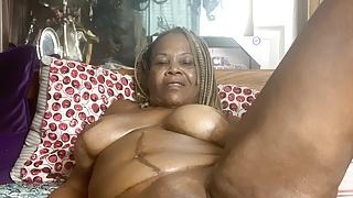 Mature Ebony Queen, Cocovonmilf is enjoying her glass dildo.