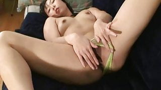 Asian wife strips and sensually fondles her neatly trimmed s