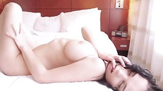 Saggy tits brunette on a bed