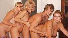 Home party with three mature mothers and son