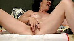 Sexy hairy mature masturbates to squirting orgasm on webcam