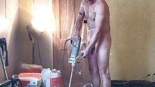 Nudist builder mixing plaster
