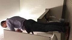 HORNY COWORKER CAUGHT PISSING HARD