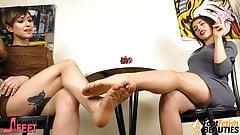 Two barefoot lesbians playing footsies