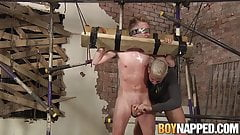 Young blond Corey Conor cannot escape BDSM blowjob wanking