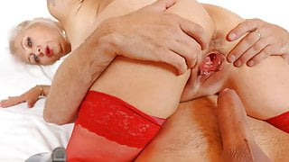 Gaping and fucking pussy of horny blonde GILF