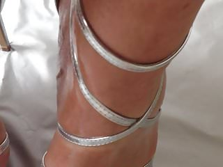 Fetish heel high stiletto wearing Oiled feets with silver toes in silver strappy stilettos