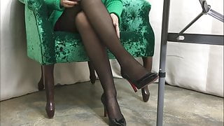 Sexy legs in black pantyhose and heels 2