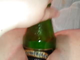 Large slut Chubby slut fucks herself with a large beer bottle