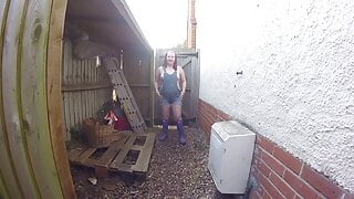 Wife in dungarees and wellingtons