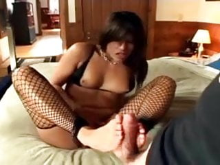Tiny foot sex Footjob in fishnet stockings and a tiny black bra