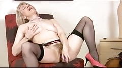 Milf in stockings uses toy