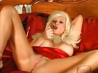 Strip filler cigars Hot busty blonde cougar smokes cigar and diddles