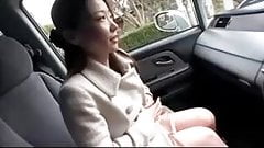 Asian MILF shows big nipples in car