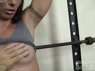 Sexy leather girl stuck with snow chains Fit sexy muscle girl is chained up in the gym