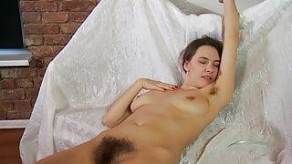 Stunning hairy Claire in orange skirt strps and masturbates