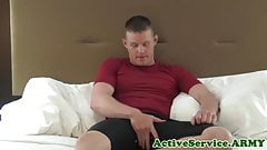 Solo army jock tugging on his fat wang