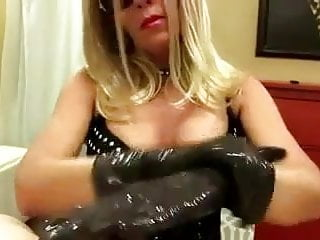 Latex gloves smother Mistress teases a slave cock with latex gloves