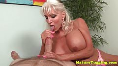 Bigboobs mature sucking and tugging cock