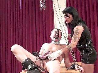 Hanged bondage - Dometria hangs him by the balls and bullwhips him