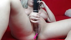 Busty blonde caresses her pussy