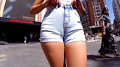 Displaying cameltoe in jean shorts through the city center