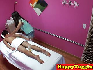 Suck and tug - Asian masseuse tugging and sucking her client