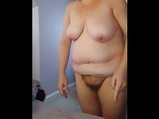Naked hairy guys Standing by the bed naked, hairy pussy, big tits