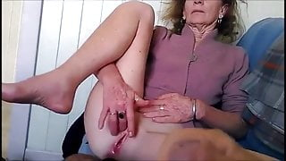 Man masturbating till he cums in front of an older woman