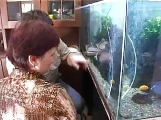 Mature cleaner Russian mommy seduces boy cleaner aquariums