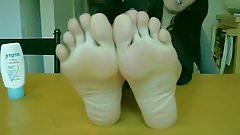 Brunette's Feet On The Table