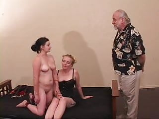 Masters male sluts Master and mistress pull on submissive sluts nipples on the bed