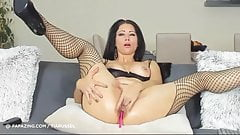 Naughty milf in fishnets plays with her holes