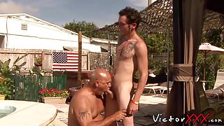 Two muscular guys have gay fuck session on a memorial day