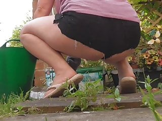 Weed pantyhose - Hot new shorts, weeding on the patio.