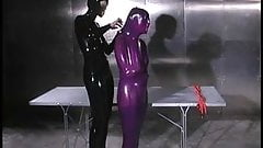 Purple latex submissive whipped on table